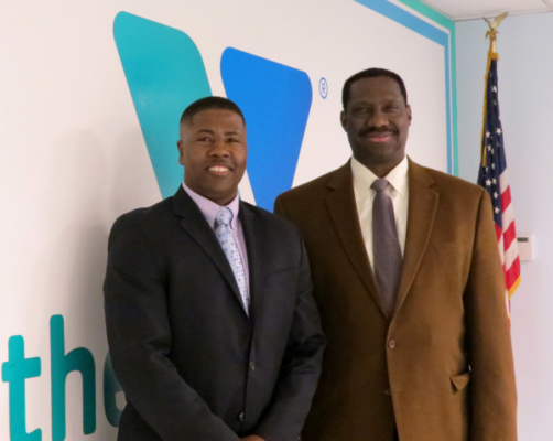 Ernest Lamour, CEO Stamford Family YMCA (L) and Herbert Parker, Executive VP of Operational Excellence at HARMAN (R) discuss the donation of audio equipment and how it will play a vital role in growing new programs at the Stamford Family Y.